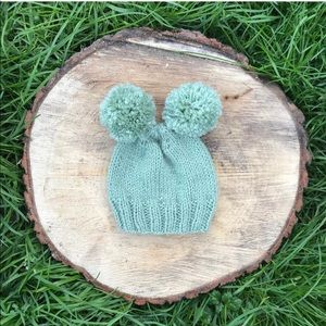 Brand new Hand knitted baby beanie with pompoms